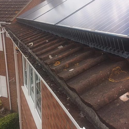 Solar panel proofing of property from pigeons gaining entry to nest.